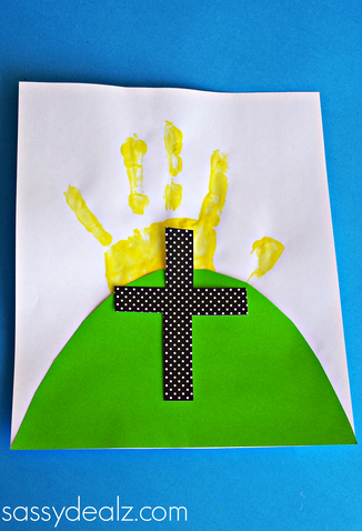 Easter Cross Craft made with card stock, green construction paper, white paper, and a yellow handprint that looks like the rising sun.